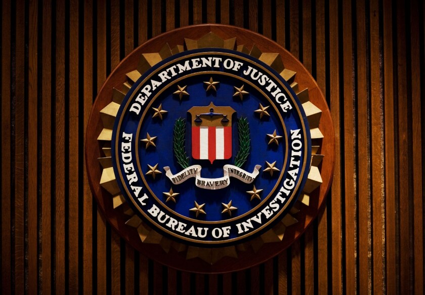 Former FBI agent pleads guilty to theft
