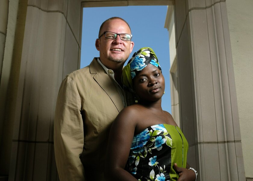Nathaniel Dunigan and his daughter, Dorah Wanyana Dunigan, at USD. Dunigan adopted Dorah shortly after she arrived at AidChild, his charity for orphans in Uganda. Earnie Grafton • U-T