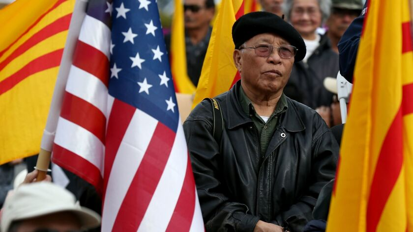 Members of the Vietnamese American community listen to state Sen. Janet Nguyen at a rally in Westminster.