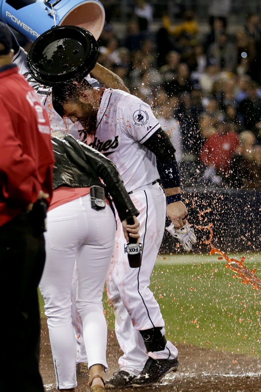 San Diego Padres' Derek Norris is doused in an energy drink after hitting a grand slam home run against the Pittsburgh Pirates in the ninth inning of a baseball game Friday, May 29, 2015, in San Diego. The Padres won, 6-2. (AP Photo/Gregory Bull)