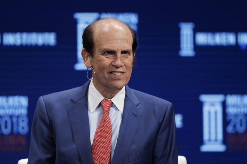 Michael Milken leads a discussion at the Milken Institute Global Conference in April 2018 in Beverly Hills.