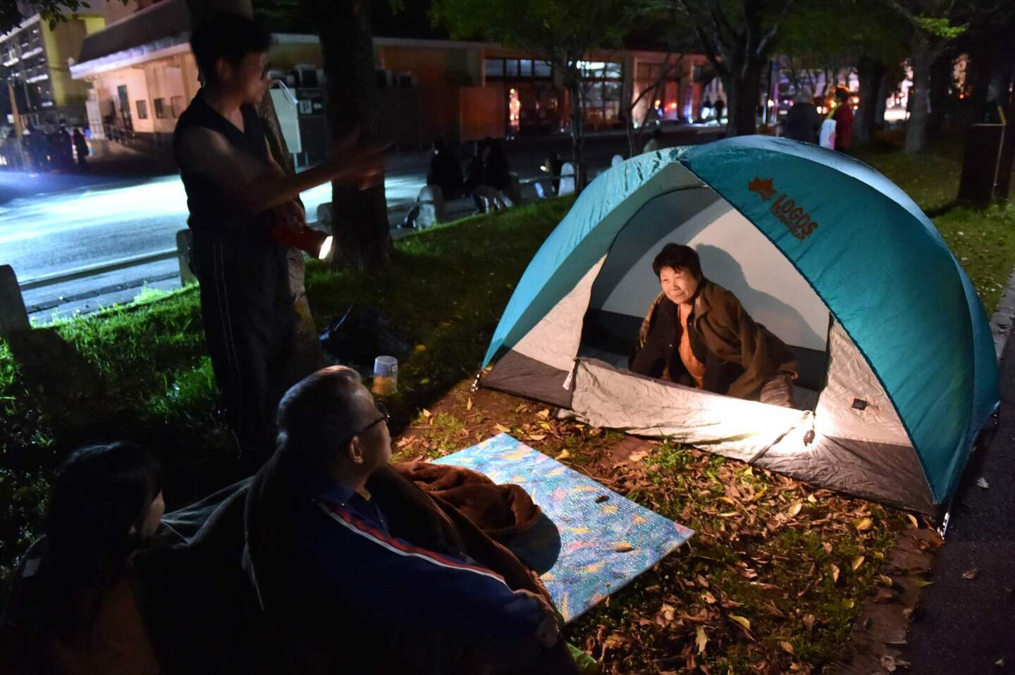 Evacuated residents wait at a park in Kumamoto city April 16 after another strong earthquake shook Japan.