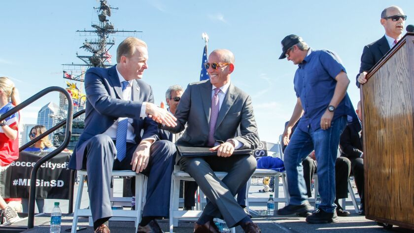 MLS Commissioner Don Garber (right) shakes hands with Mayor Kevin Faulconer during a Major League Soccer news conference on the USS Midway Jan. 30, 2017.