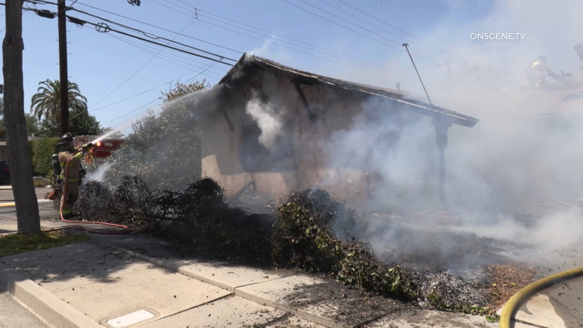 Firefighters battled a fire that spread from a garage to an attic in San Carlos on Monday afternoon.