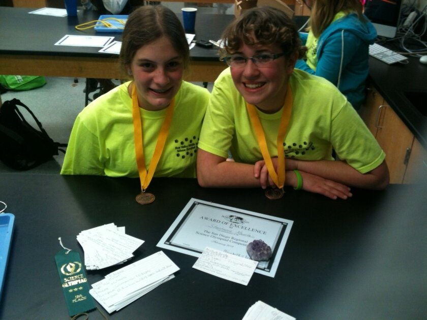 Grace Tick (right) and Stephanie Mountain, Bear Valley Middle School eighth-graders, paired up for the Science Olympiad's rocks and minerals category.