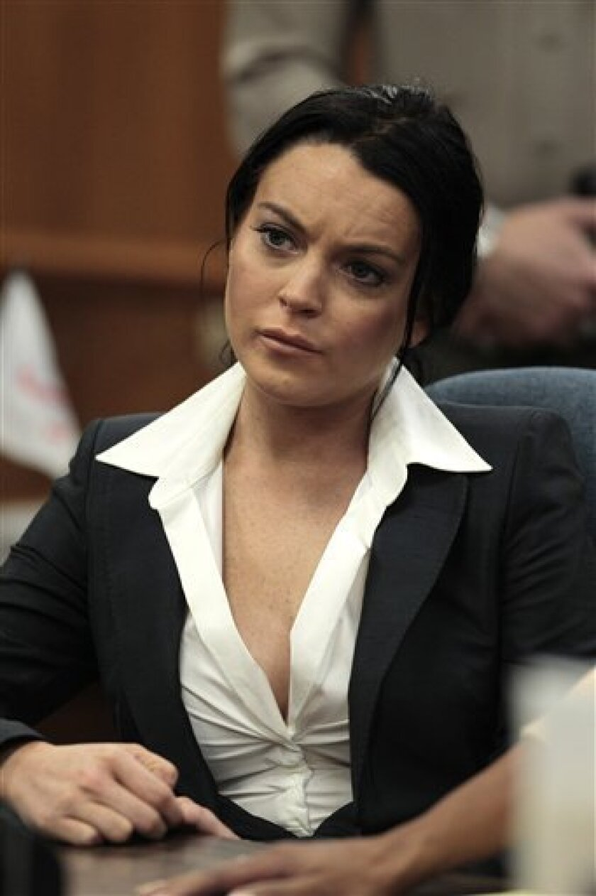 FILE - In this May 24, 2010 file photo, actress Lindsay Lohan appears in a courtroom for a hearing in Beverly Hills, Calif. (AP Photo/Jae C. Hong, file)
