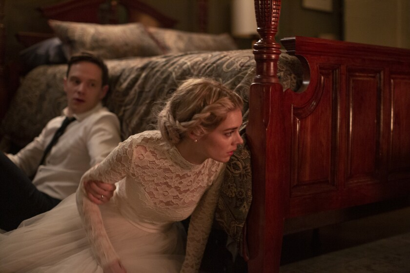 """Mark O'Brien and Samara Weaving in the film """"Ready or Not."""""""