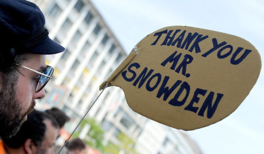 Hundreds of demonstrators rally in Germany against the U.S. National Security Agency's electronic surveillance programs revealed by former NSA consultant Edward Snowden.