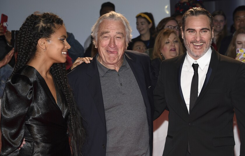 "Zazie Beetz, Robert De Niro and Joaquin Phoenix attend a premiere for ""Joker"" on Sept. 9 at the Toronto International Film Festival."