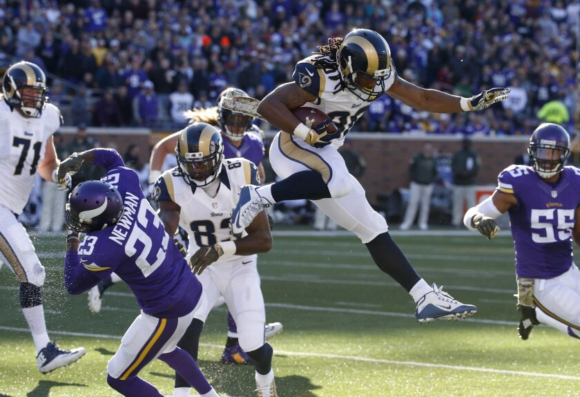 St. Louis Rams running back Todd Gurley (30) leaps over Minnesota Vikings cornerback Terence Newman (23) during the second half of an NFL football game Sunday, Nov. 8, 2015, in Minneapolis. (AP Photo/Ann Heisenfelt)