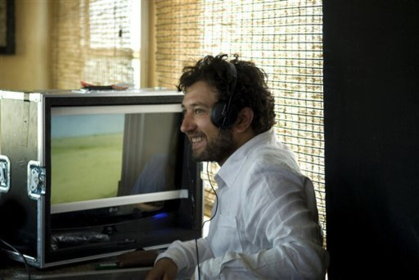 In this 2010 photo, Syrian opposition filmmaker Meyar AL-Roumi works at a studio in Damascus, Syria. Syria's civil war has driven wedges through many parts of society, with violence that has killed more than 40,000 people exacerbating differences in class, ideology and religion. Reflecting how deep these divisions run is the near complete split of Syria's artists into pro- and anti-regime camps. Although Syria's writers, musicians and filmmakers fight with sharply worded statements instead of guns and tanks, their mutual animosity bodes ill for reconciliation should Bashar Assad fall. (AP Photo/Adel Samara)