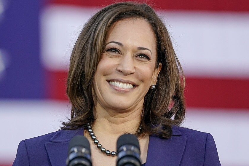 Kamala Harris behind the microphone at a 2019 rally in Oakland.
