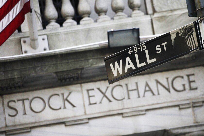The Wall Street sign outside the New York Stock Exchange.