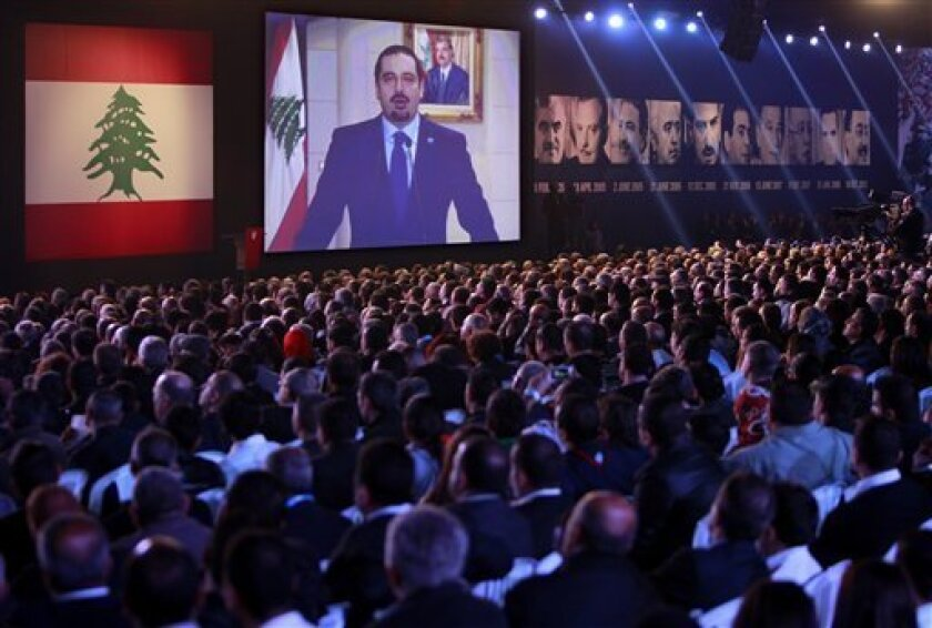 Former Lebanese Prime Minister Saad Hariri speaks via a video link from Paris during a ceremony to mark the eighth anniversary of the assassination of his father, former Prime Minister Rafik Hariri, in Beirut, Lebanon, Thursday, Feb. 14, 2013. Rafik Hariri was killed in a massive truck bombing in B