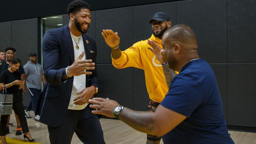 EL SEGUNDO, CALIF. -- SATURDAY, JULY 13, 2019: Newly announced Lakers player Anthony Davis greets f