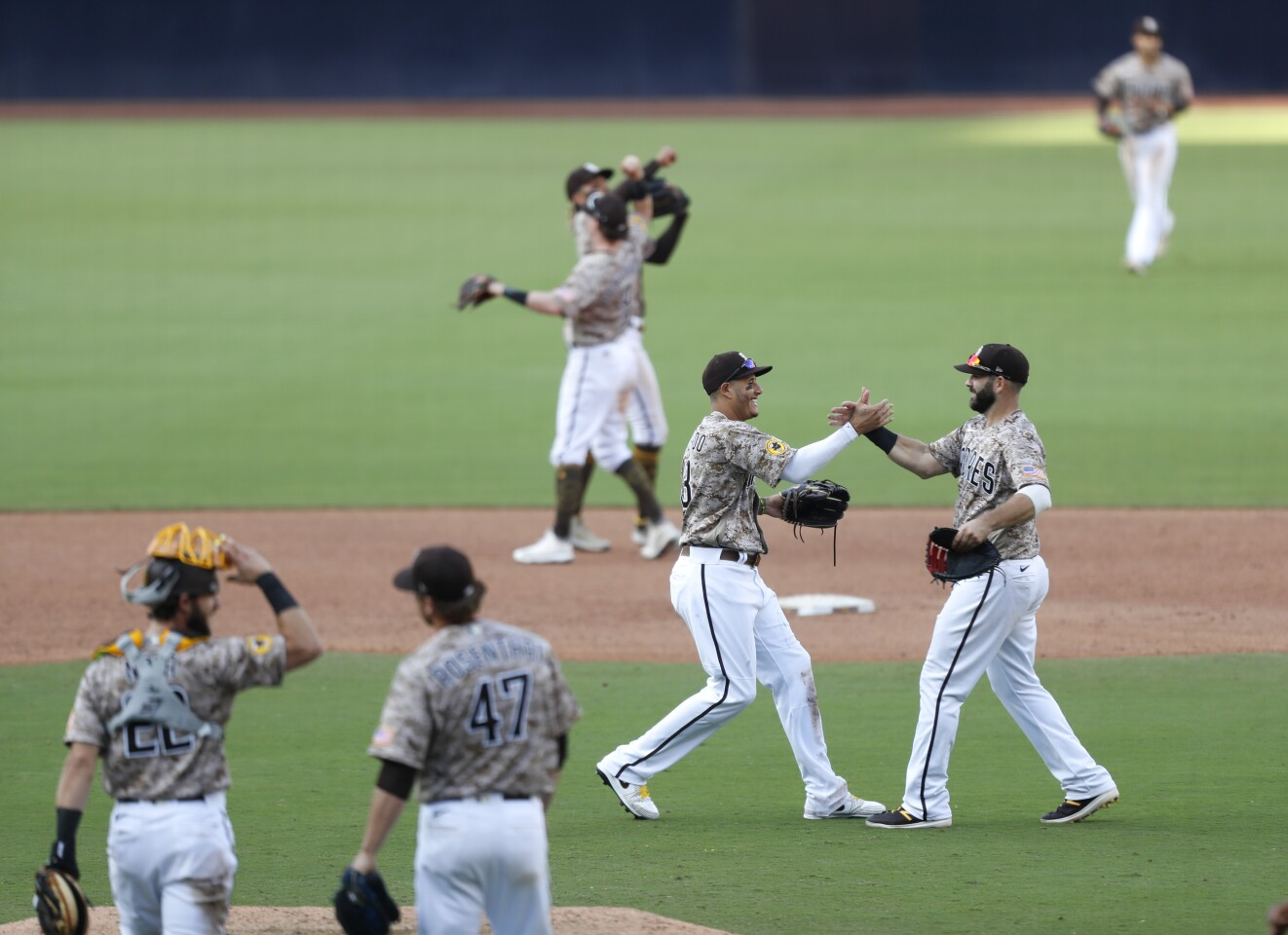 The San Diego Padres, including Manny Machado and Mitch Moreland, center, celebrate after beating the Seattle Mariners