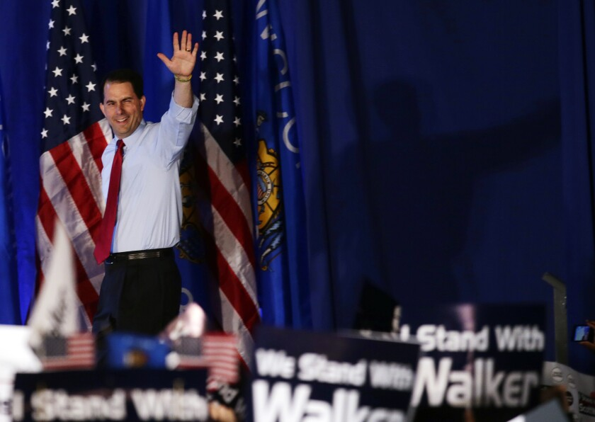 Gov. Scott Walker waves at his victory party in 2012.