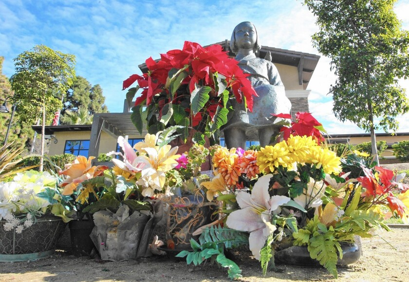 """Flowers lie at the Glendale memorial to """"comfort women."""""""