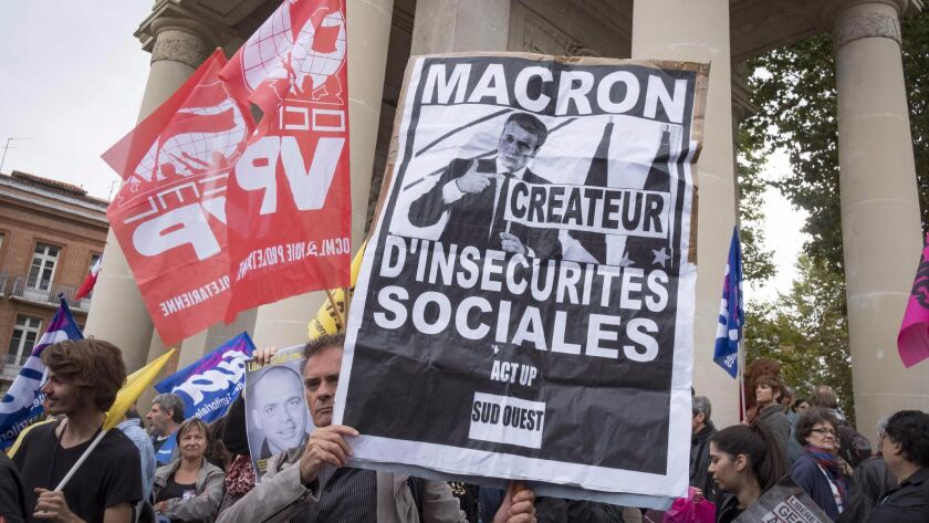 Demonstrators gather in Toulouse, France, on Monday to protest labor law reforms supported by Presid