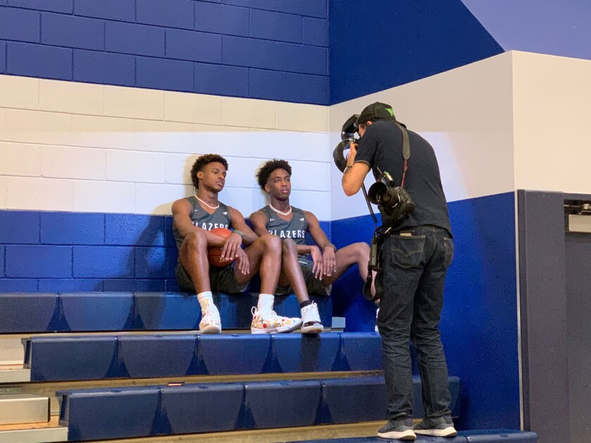 Teammates Bronny James, left, and Zaire Wade pose for a photo during Sierra Canyon High's media day on Thursday.