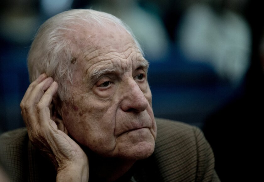 """FILE- In this March 5, 2013 file photo, former dictator Reynaldo Bignone attends the first day of the trial for his alleged involvement in the so called operation, """"Plan Condor,"""" in Buenos Aires, Argentina. The last military president in Argentina's 1976-1983 dictatorship received another prison sentence on Tuesday Oct. 7, 2014, this time for the kidnapping and torture of 32 factory workers. A court in Buenos Aires sentenced Reynaldo Bignone to 23 years in prison for the human rights violations. (AP Photo/Natacha Pisarenko, File)"""