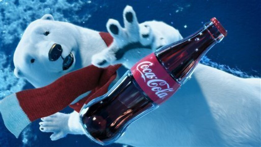 """This scene from an advertisement provided by the Coca-Cola Co. and Wieden + Kennedy, shows the polar bear tumbling through the air trying to catch his bottle of Coca-Cola before it falls to the ground. The """"Catch,"""" ad will be aired during Super Bowl XLVI, Sunday, Feb. 5, 2012."""
