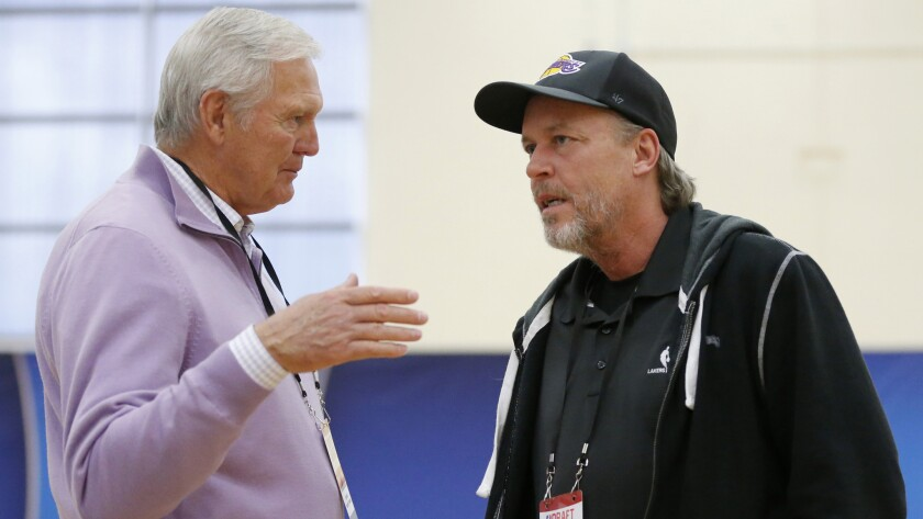 Jim Buss, part-owner and executive vice president of basketball operations of the Lakers, speaks with Lakers great Jerry West, left, during the NBA draft combine in Chicago.