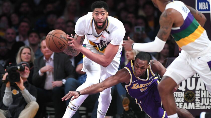 LOS ANGELES, CALIFORNIA FEBUARY 6, 2019-Pelicans Anthony Davis has the ball stripped by Lakers Rajon