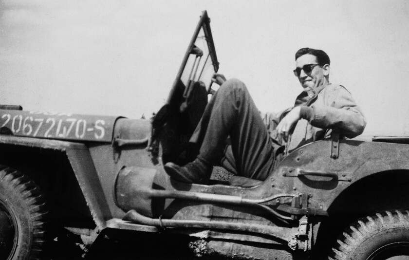 """In a photo from the movie """"Salinger,"""" J.D. Salinger sits in his jeep after the liberation of Paris, 1944."""