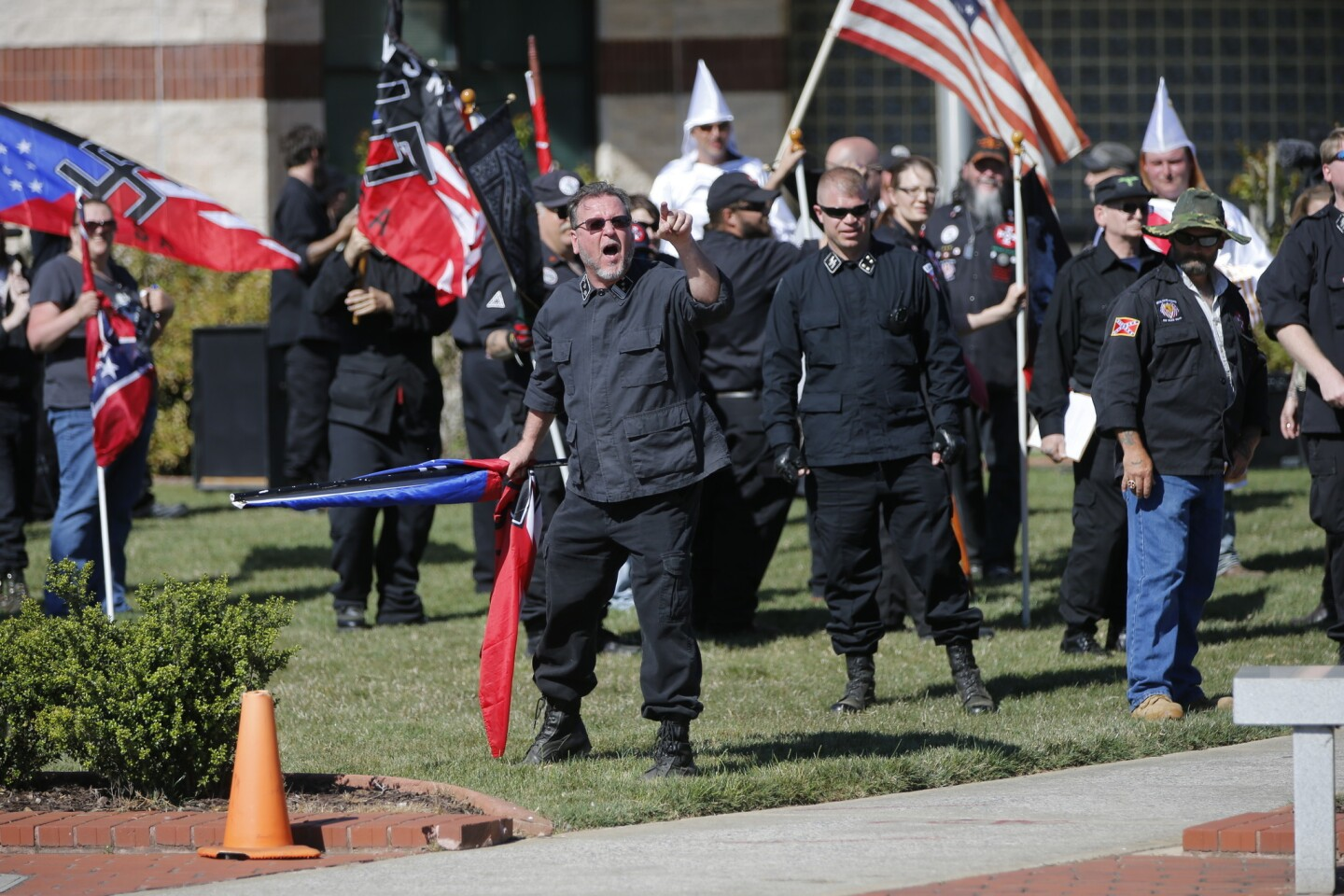 """Members of the Ku Klux Klan take part in a """"white pride"""" rally in Rome, Ga., in April. Klan leaders say they believe U.S. politics are going their way, as a nationalist, us-against-them mentality deepens across the nation."""