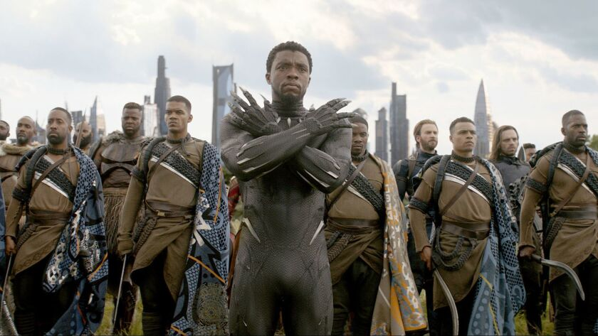 """Black Panther/T'Challa (Chadwick Boseman), center, and in background, M'Baku (Winston Duke), Captain America (Chris Evans) and Winter Soldier (Sebastian Stan) and other characters in """"Avengers: Infinity War."""""""