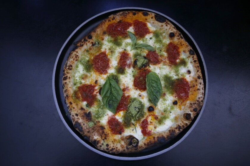 The neo-Margherita pizza, cooked in a wood oven by chef Daniele Uditi at Pizzana in Brentwood, June 12, 2017.