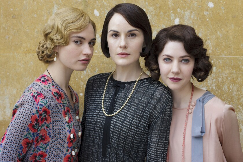 """Left to right, Lily James as Lady Rose, Michelle Dockery as Lady Mary and Catherine Steadman as Mabel Lane Fox on """"Downton Abbey."""""""