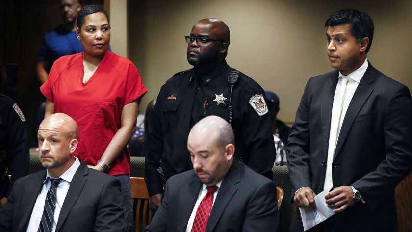 Sherra Wright, left, glances at attorney Juni Ganguli, right, after her lawyers Steve Farese and Blake Ballin asked to be withdrawn from representing her in Shelby County Criminal Court in Memphis on July 11.