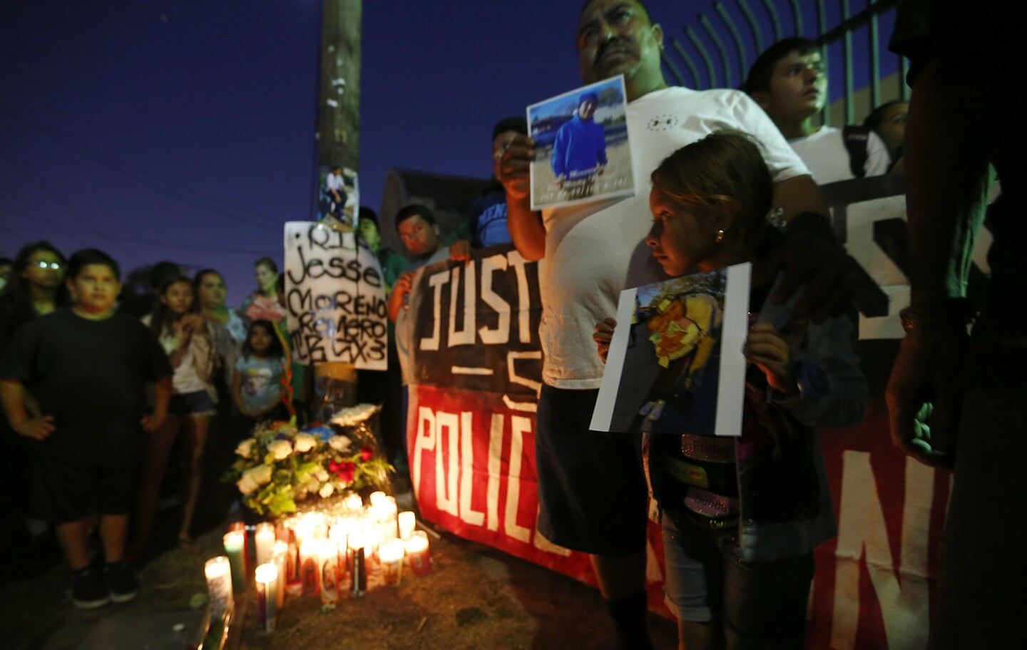 Boyle Heights residents gather near the intersection of Breed Street and Cesar Chavez Avenue on Wednesday night to protest the fatal officer-involved shooting of Jesse Moreno Romero.