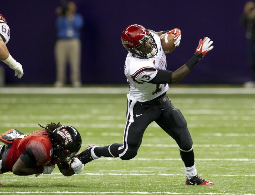 Ronnie Hillman tries to avoid a tackler in the New Orleans Bowl, his last game at SDSU.