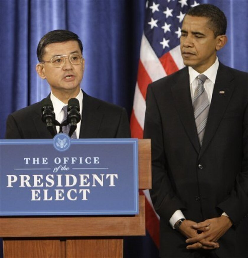 President-elect Barack Obama listens after introducing former Army chief of staff, retired Gen. Eric K. Shinseki as his Veterans Affairs Secretary-designate during a news conference Sunday, Dec. 7, 2008 in Chicago. (AP Photo/M. Spencer Green)