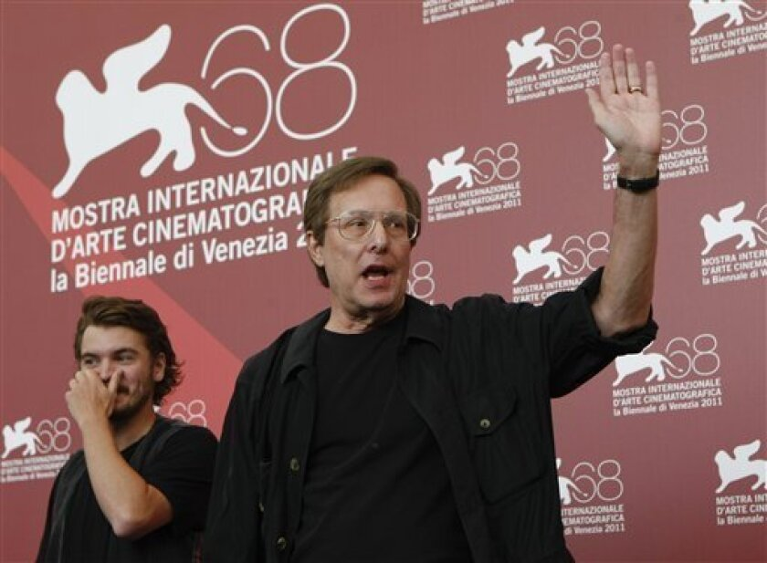 Actor Emile Hirsch, left, and director William Friedkin pose during the photo call for the film Killer Joe at the 68th edition of the Venice Film Festival in Venice, Italy, Thursday, Sept. 8, 2011. (AP Photo/Andrew Medichini)