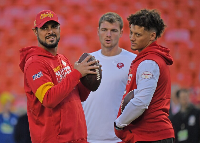 From left, quarterbacks Matt Moore, Kyle Shurmur and  Patrick Mahomes share a moment before a game in October.