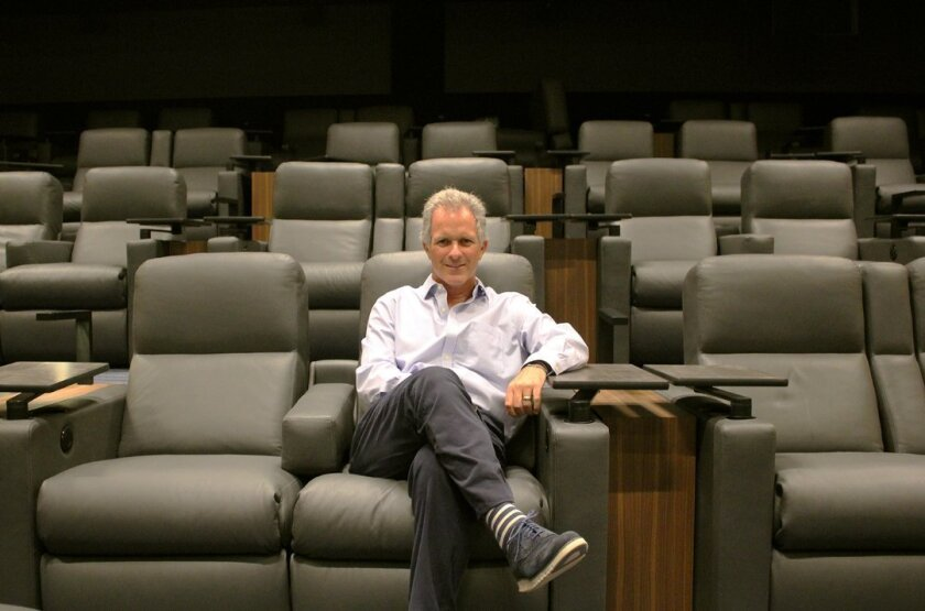 La Jolla resident Adolfo Fastlicht, owner and CEO of The Lot theater and dining complex at 7611 Fay Ave., La Jolla, relaxes in a spacious leather seat inside one of its seven theaters. The Lot is scheduled to open Sept. 30, 2015.