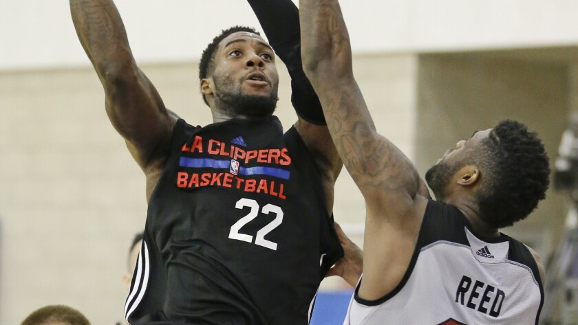 Clippers forward Branden Dawson shoots over Miami Heat center Willie Reed during a summer league game in Orlando, Fla., on July 8.