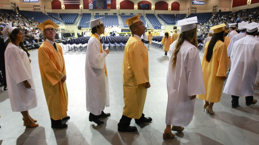 Serra High School seniors graduated during commencement exercises in the Jenny Craig Pavilion on the campus of the University of San Diego in June 2015. (Howard Lipin/The San Diego Union-Tribune)