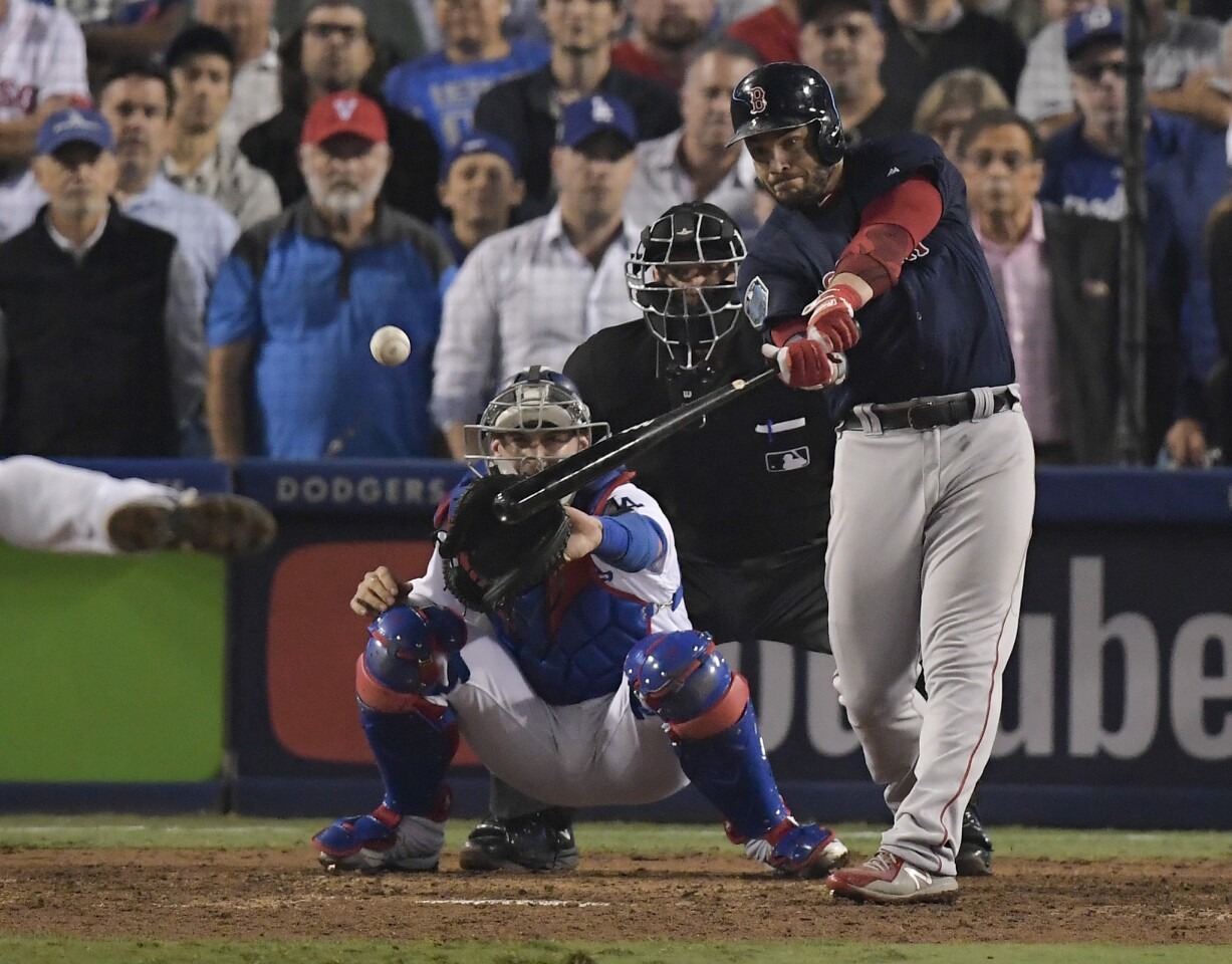 Boston Red Sox's Steve Pearce hits a three RBI-double against the Los Angeles Dodgers during the ninth inning in Game 4 of the World Series baseball game on Saturday, Oct. 27, 2018, in Los Angeles. (AP Photo/Mark J. Terrill)