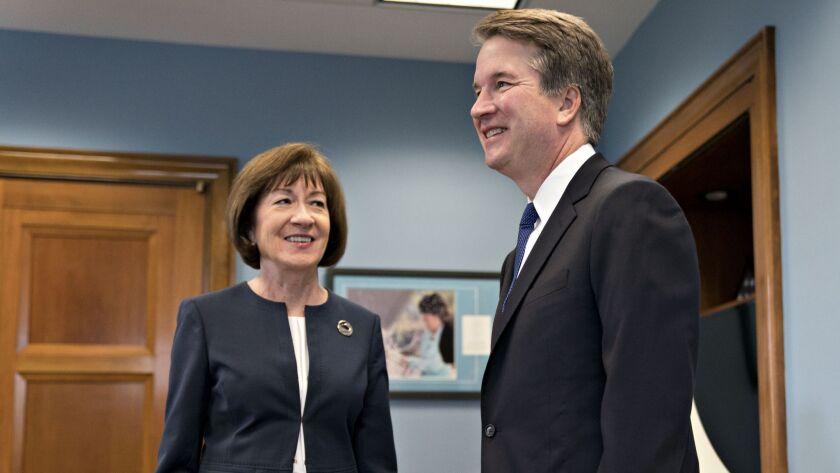In this file photo from August of 2018, Sen. Susan Collins, R-Maine, meets Supreme Court nominee Brett Kavanaugh on Capitol Hill.