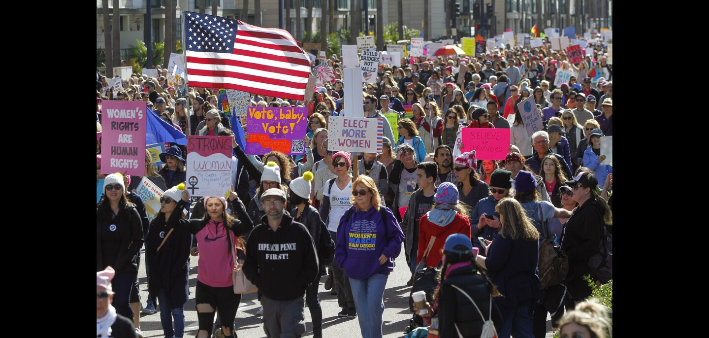 People walk north on Pacific Highway during the San Diego Women's March.