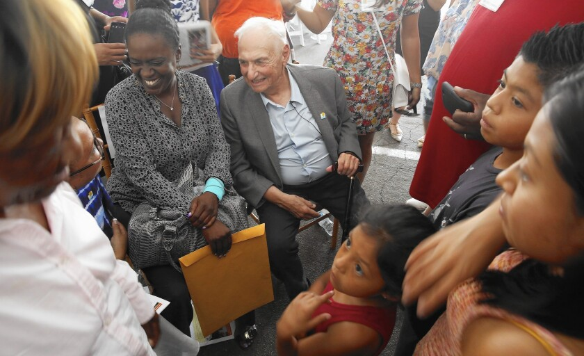Architect Frank Gehry is surrounded by children at the unveiling of his design for the future Watts campus of the Children's Institute.