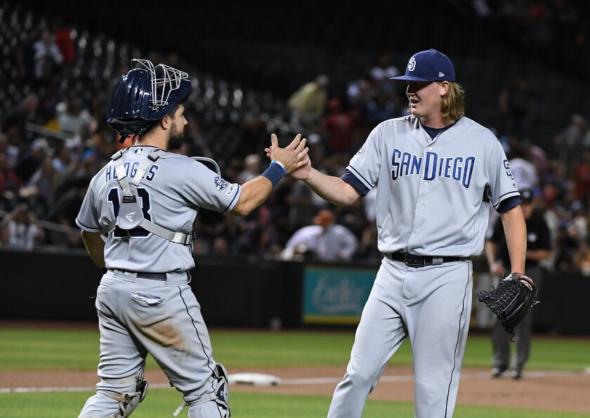 Trey Wingenter and Austin Hedges celebrate a 7-6 win against the Arizona Diamondbacks at Chase Field on April 11.
