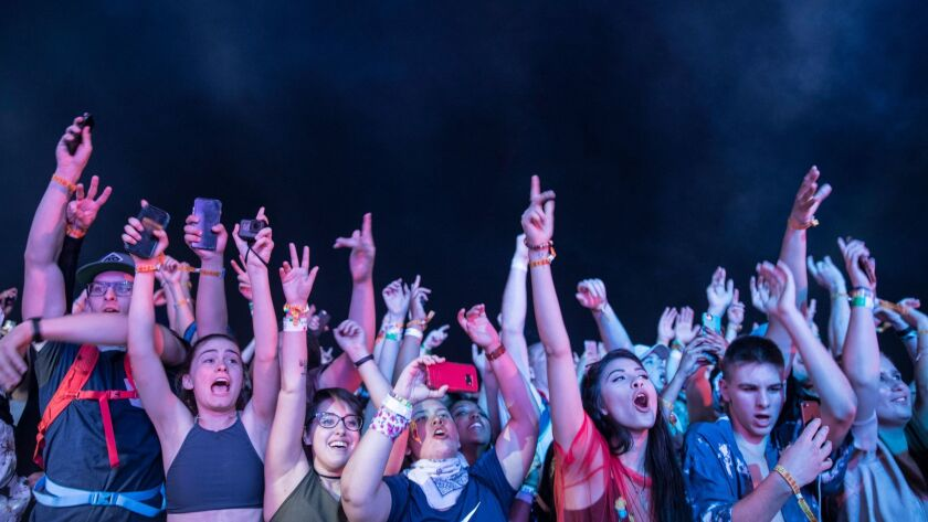 INDIO, CALIF. -- SATURDAY, APRIL 15, 2017: Fans jump to ScHoolboy Q onstage at the Coachella Music