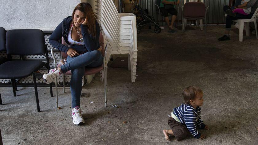 TIJUANA, MEXICO - JUNE 8, 2018: Waiting at the border, Synthia Savllon,19 of Honduras spends long h