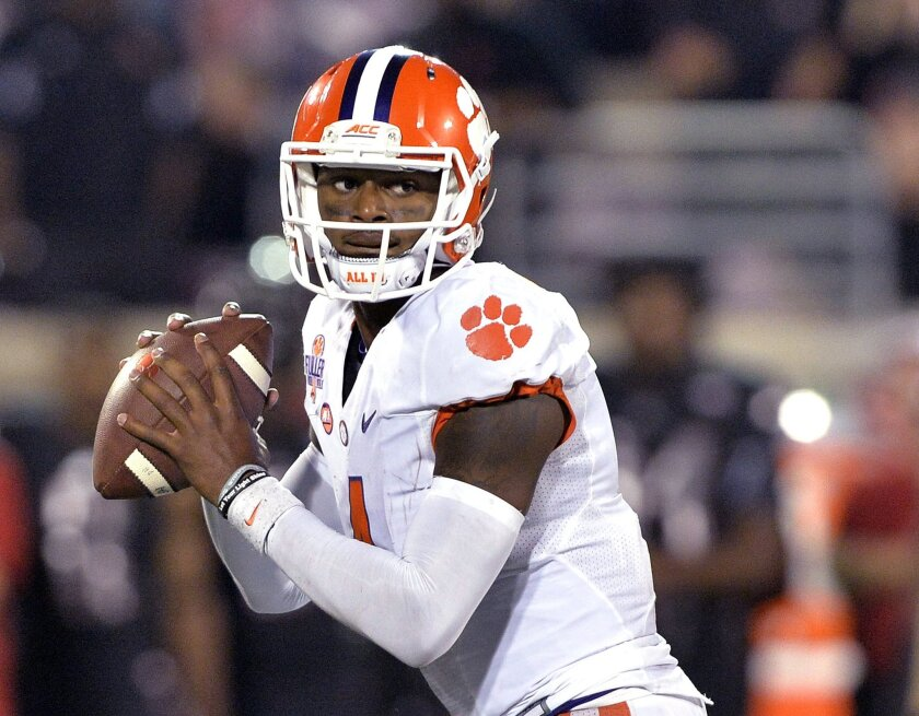 FILE - In this Sept. 17, 2015, file photo, Clemson quarterback Deshaun Watson looks for a receiver during the second half of an NCAA college football game against Louisville in Louisville, Ky. In the ACC, No. 3 Clemson hosts No. 17 Florida State on Saturday, Nov. 7, 2015. Clemson would clinch the A